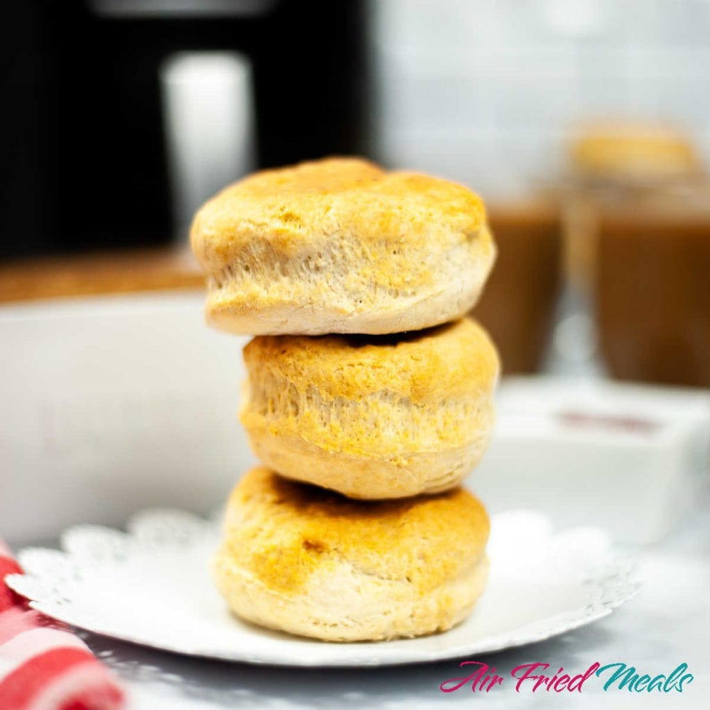 3 biscuits stacked on a white plate.