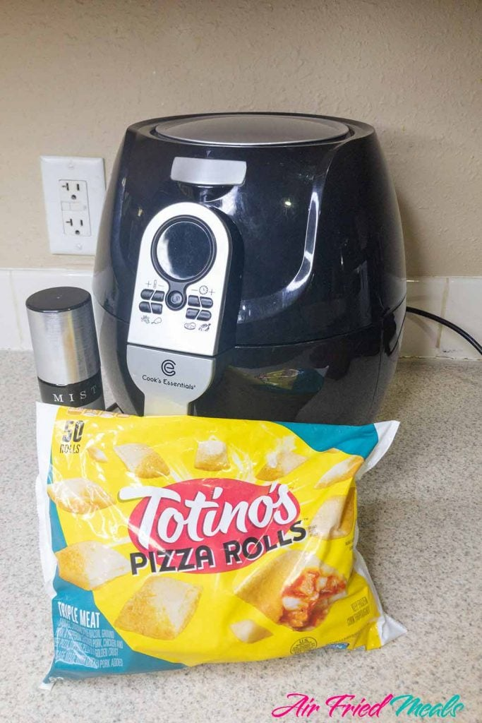 black air fryer, mister bottle next to it with Totino's Pizza Rolls package in front