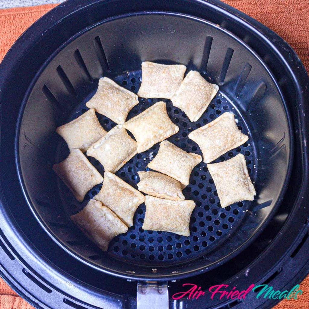 frozen pizza rolls at bottom of air fryer basket