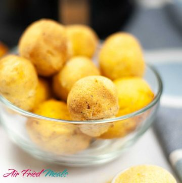 air fryer hush puppies in a clear bowl.