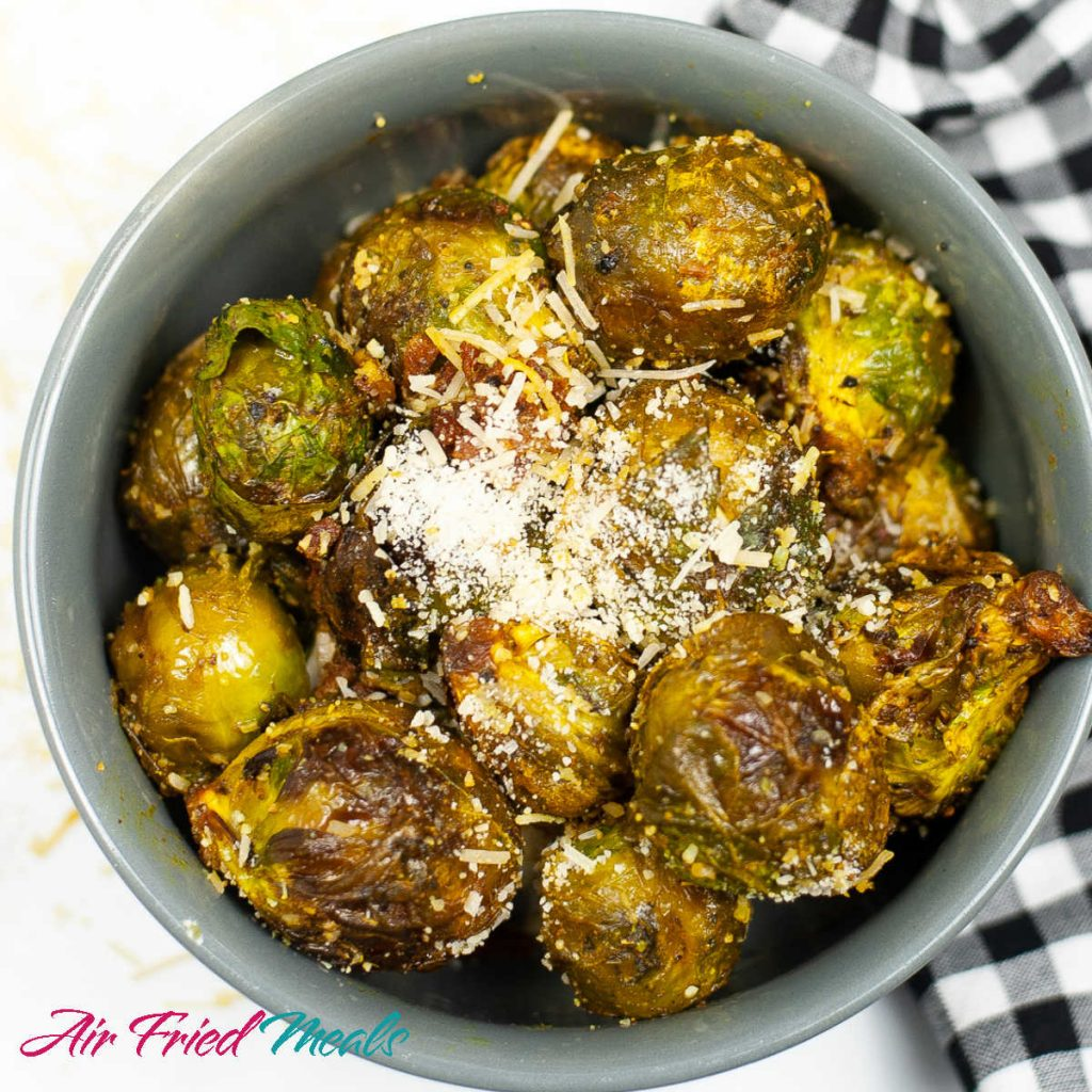 bowl of air fried Brussel sprouts with parmesan on it.