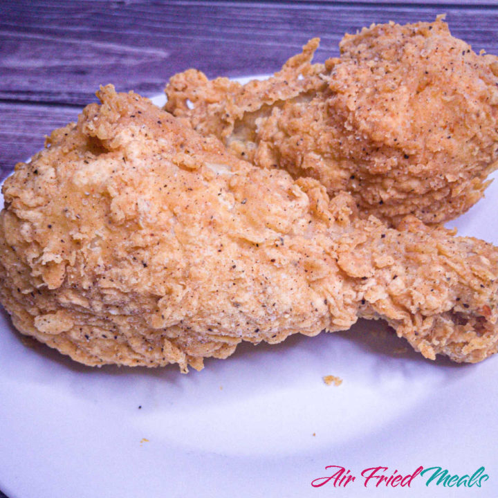 two pieces of fried chicken on a plate.
