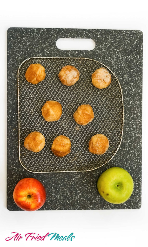 Donut holes on a grate.
