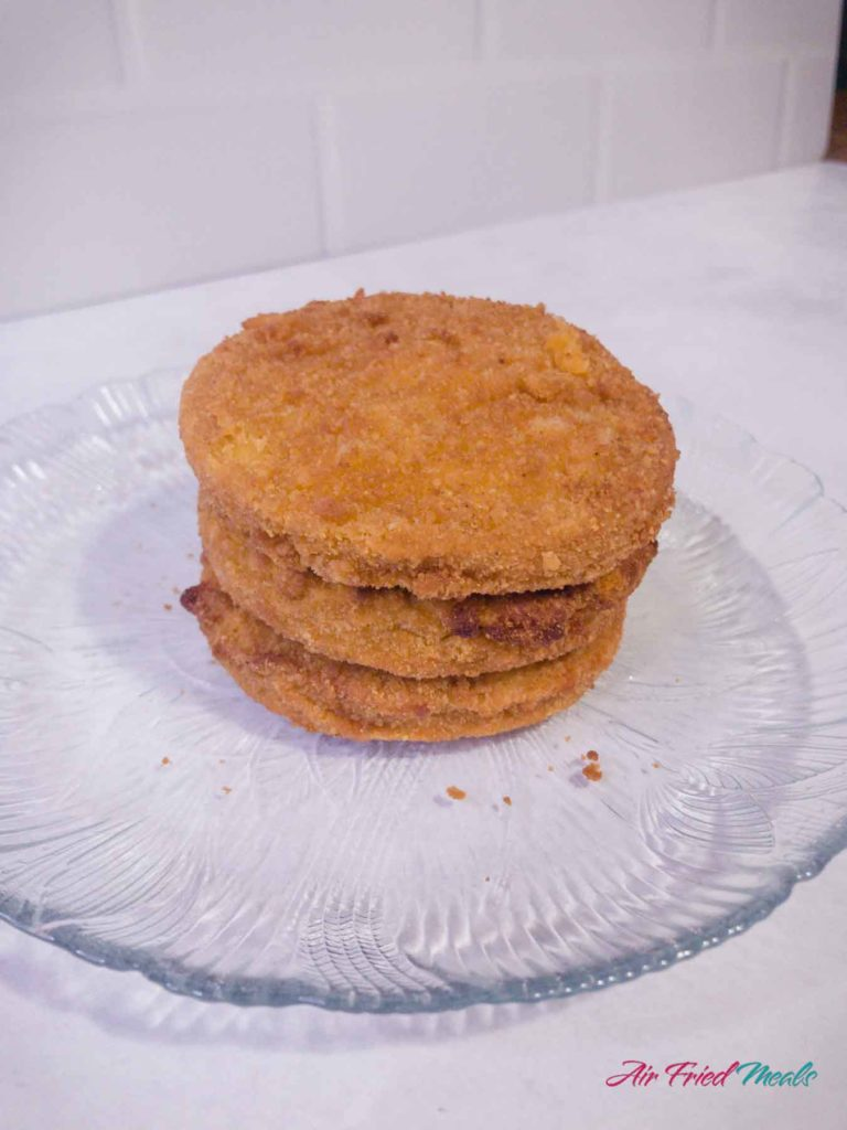 Stack of cooked chicken patties.
