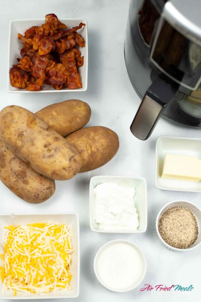 Ingredients - bacon, russet potatoes, shredded cheese, sour cream, butter, heavy cream, seasonings.